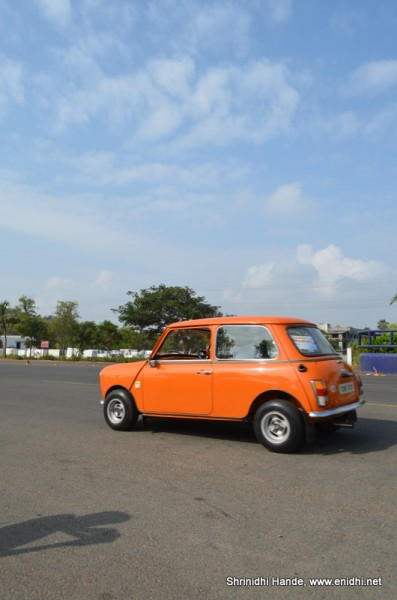 mini cooper in action rear side profle