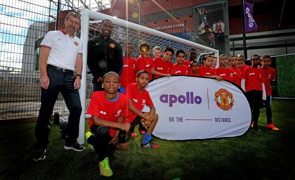 Pitch Perfect: Manchester United legends Denis Irwin and Andrew Cole at the launch of the new Apollo community pitch in the shadow of Old Trafford; the pitch is made from recycled tyre rubber.