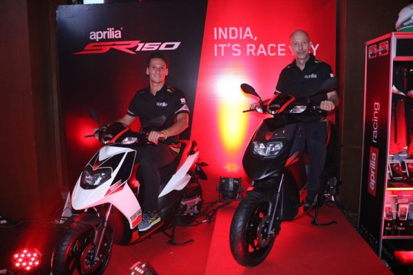 L-to-R-Lorenzo-Savadori-2015-World-Champion-of-Superstock-bike-racing-alongwith-Mr.-Stefano-Pelle-Managing-Director-and-CEO-–-PVPL-at-the-launch-of-SR-150-in-Mumbai